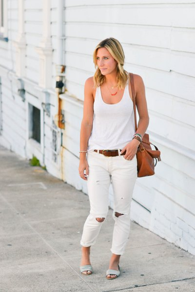 white tank top with scoop neckline and ripped jeans