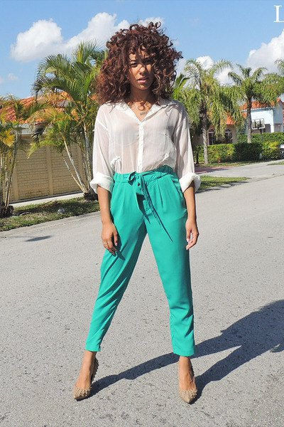 white, semi-transparent blouse with gray, high-waisted, short-cut chinos