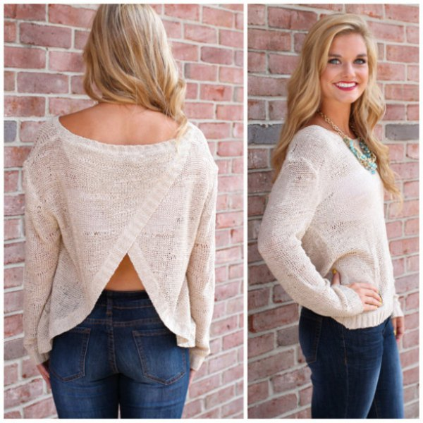 white, semi-transparent sweater with a discreetly open back and blue skinny jeans
