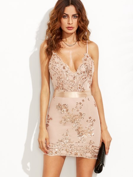 white form-fitting chiffon dress embroidered with sequins