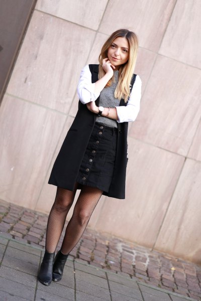 white shirt, black long vest and button skirt