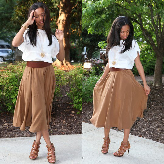 white short-sleeved blouse with a green midi skirt