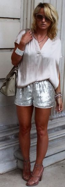 white short-sleeved blouse with silver sequin shorts