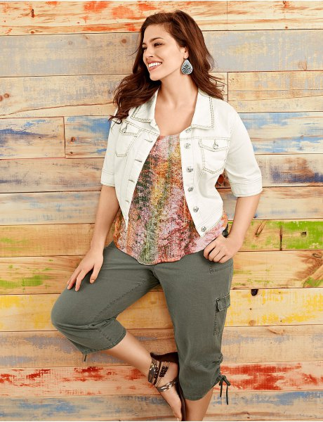 white short-sleeved denim jacket with a colorful top and cargo shorts