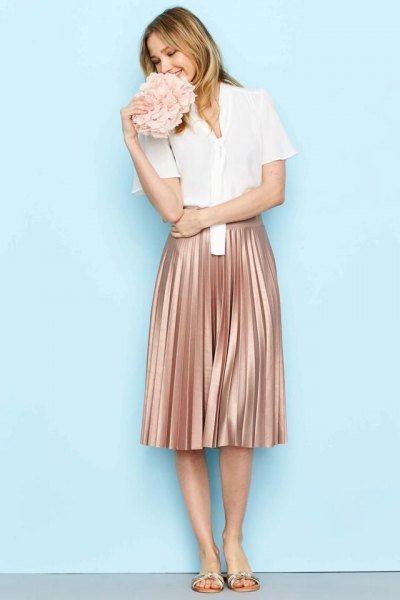 white short-sleeved shirt with rose gold-colored pleated skirt