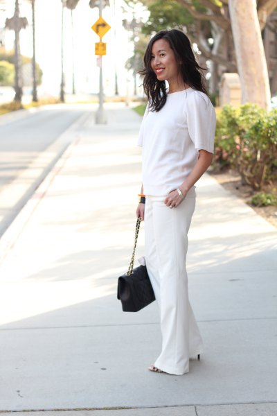 white short-sleeved sweater with wide-cut suit trousers
