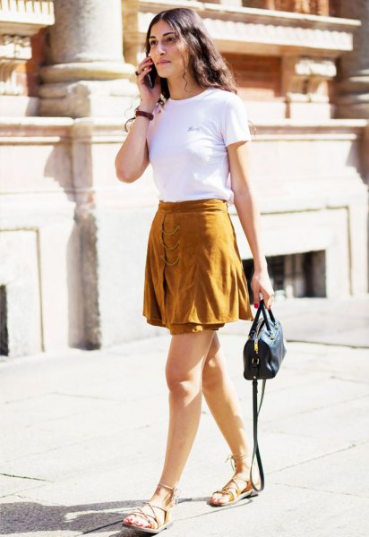 white short-sleeved T-shirt with green minirater skirt