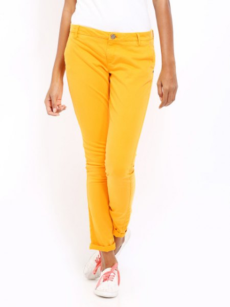 white short-sleeved T-shirt with lemon yellow slim fit trousers