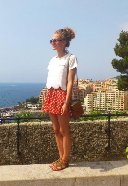 white short-sleeved top with red and white polka dot mini skirt