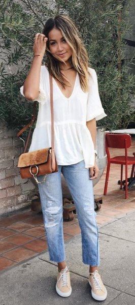 white short-sleeved peplum blouse with V-neck and boyfriend jeans