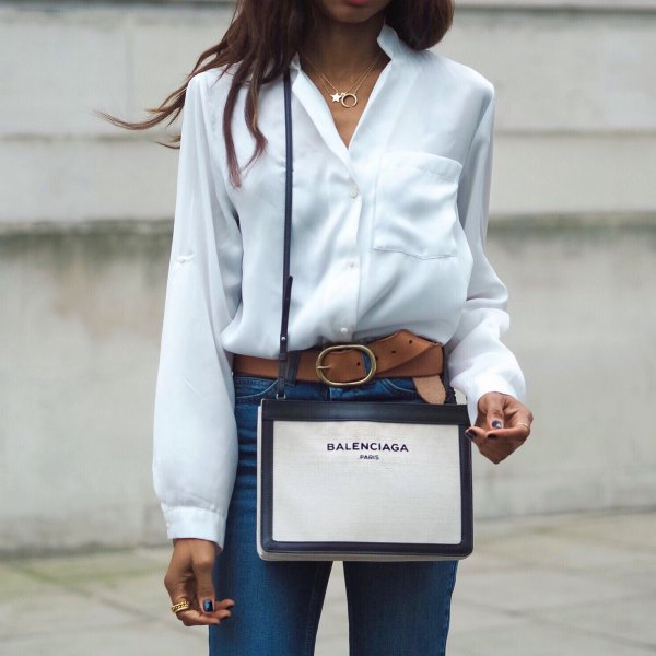 white silk shirt with buttons and blue high-waisted jeans