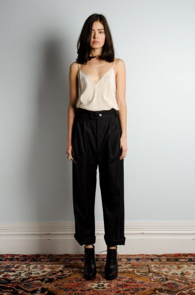 white silk shirt black high waisted jeans with wide legs