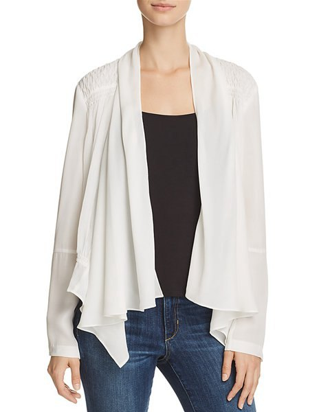 white silk jacket with black vest top and blue skinny jeans