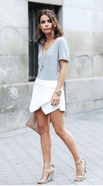 white skort gray t-shirt necklace