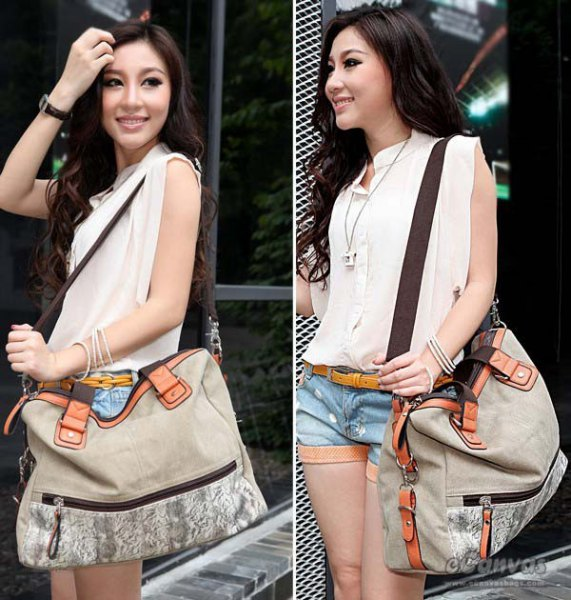 white sleeveless blouse with blue denim shorts and light gray shoulder bag