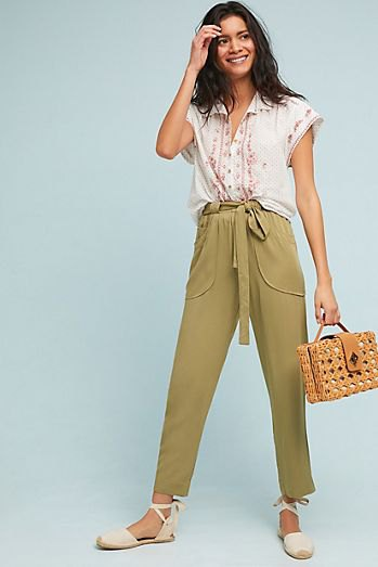 white sleeveless blouse with green, short-cut chinos