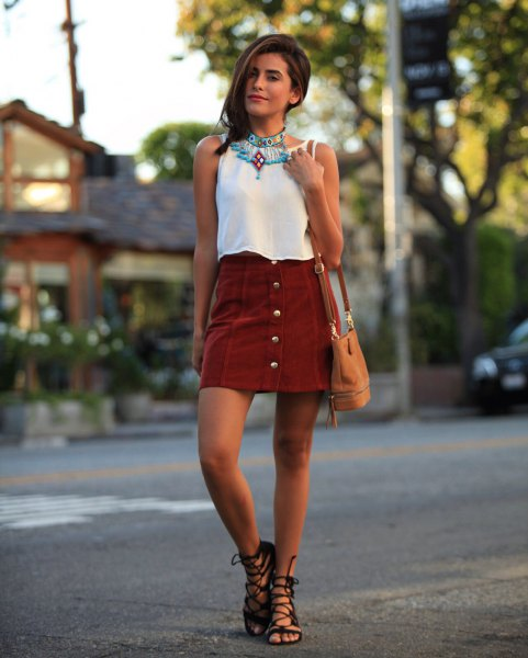 white sleeveless blouse with gray mini skirt with button placket