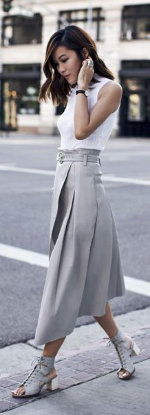 white sleeveless blouse with gray pleated skirt