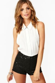 white sleeveless blouse with buttons and black mini-shorts
