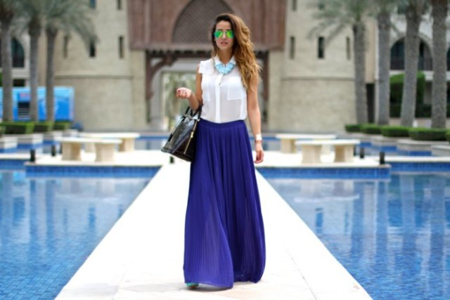 white sleeveless shirt with buttons and blue chiffon pleated maxi skirt