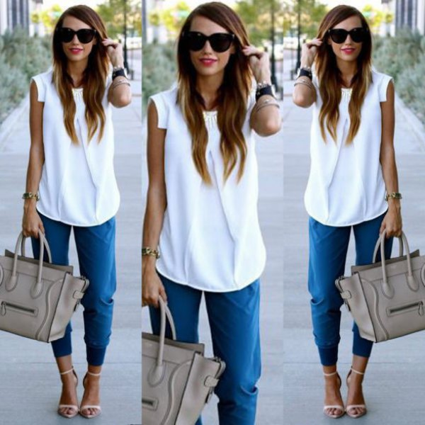 white sleeveless chiffon blouse with blue trousers with tapered legs