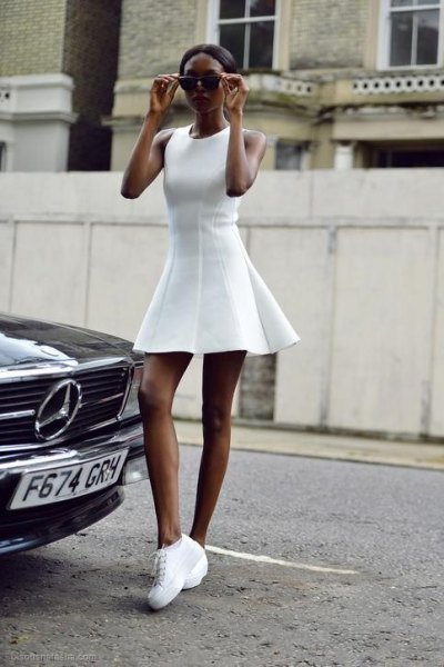 white sleeveless mini dress with fit and flare with tennis platform shoes