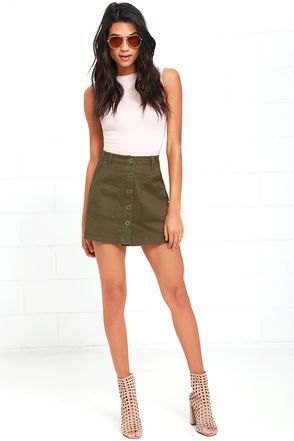 white sleeveless top with an olive green mini skirt with button placket
