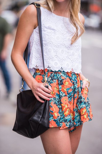 white sleeveless lace top with orange flowing shorts
