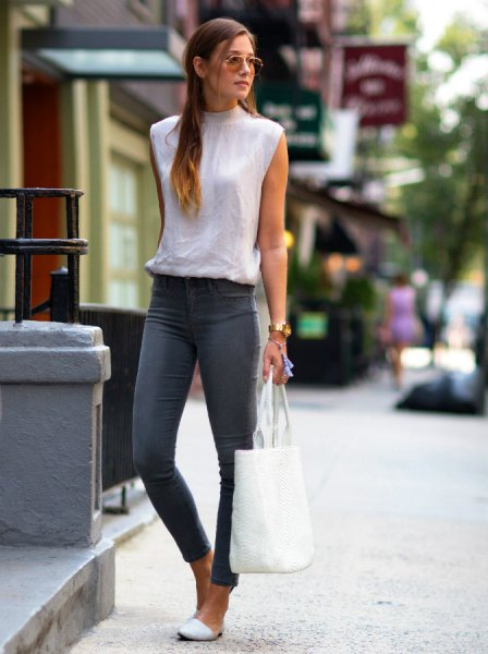 white sleeveless mock neck blouse gray skinny jeans