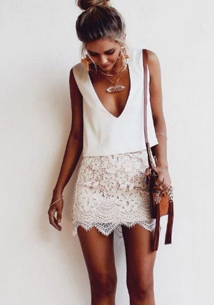white sleeveless two-piece lace dress with plunging neckline