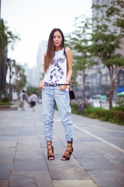 white t-shirt with sleeveless print and jogger jeans