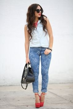 white sleeveless shirt blue skinny jeans with floral pattern