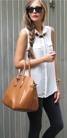 white sleeveless shirt gray skinny jeans