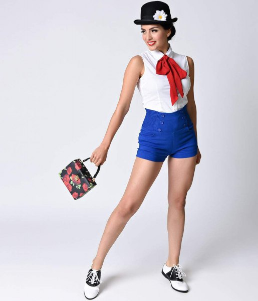 white sleeveless shirt with red bow tie and royal blue stretch shorts