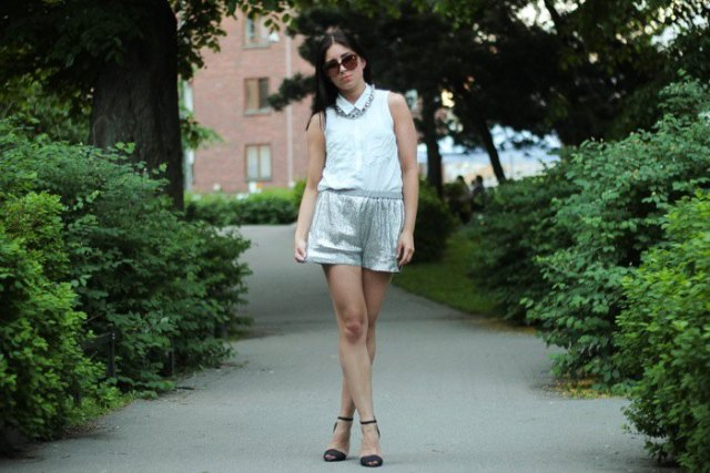white sleeveless shirt with silver metallic mini shorts