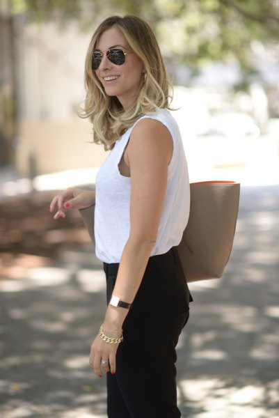 white sleeveless top with black chinos