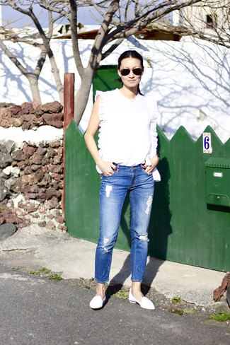 white sleeveless top with blue jeans and leather loafers