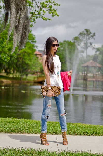 white sleeveless top with long boho necklace and clutch with leopard print