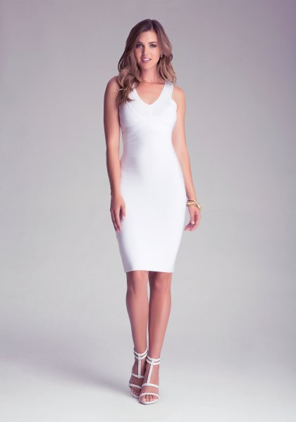 white sleeveless, figure-hugging midi dress with V-neck