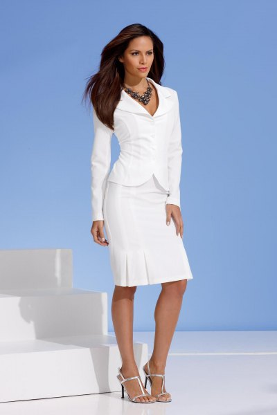 white slim fit blazer with matching knee-length skirt with a straight cut