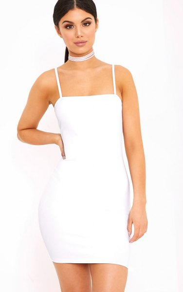 white, figure-hugging dress with spaghetti straps