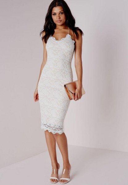 white dress with spaghetti strap and figure-hugging hem with clutch