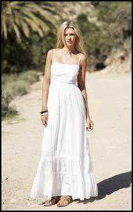 white floor-length airy dress with spaghetti strap