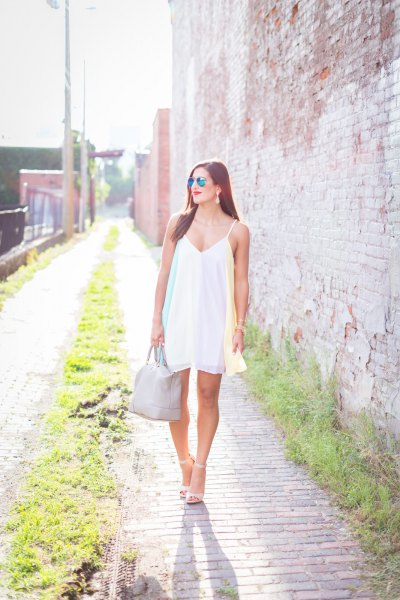 white swing dress with V-neckline and spaghetti straps