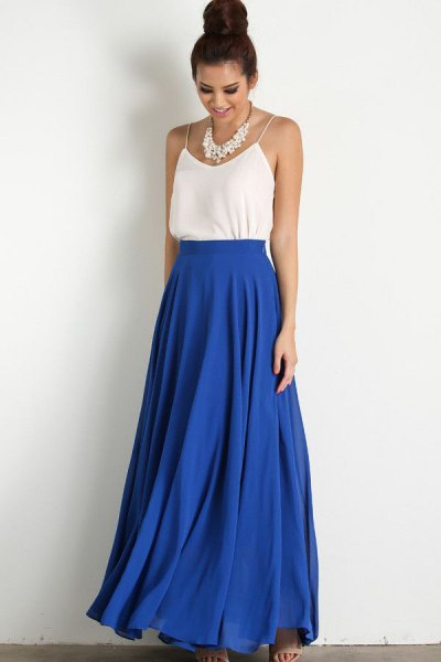 white top with spaghetti straps and blue, high-waisted maxi skirt