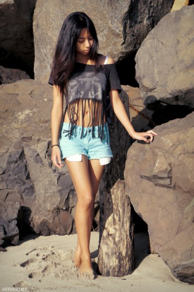white sports bra top black short t-shirt with fringes