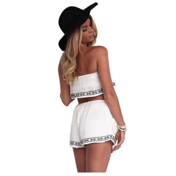 white strapless crop top with mini-shorts in tribal style