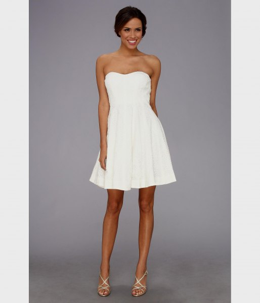 white strapless fit and flare mini dress with strappy heels