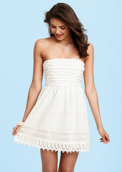 white strapless fit and flared mini lace dress with scalloped hem