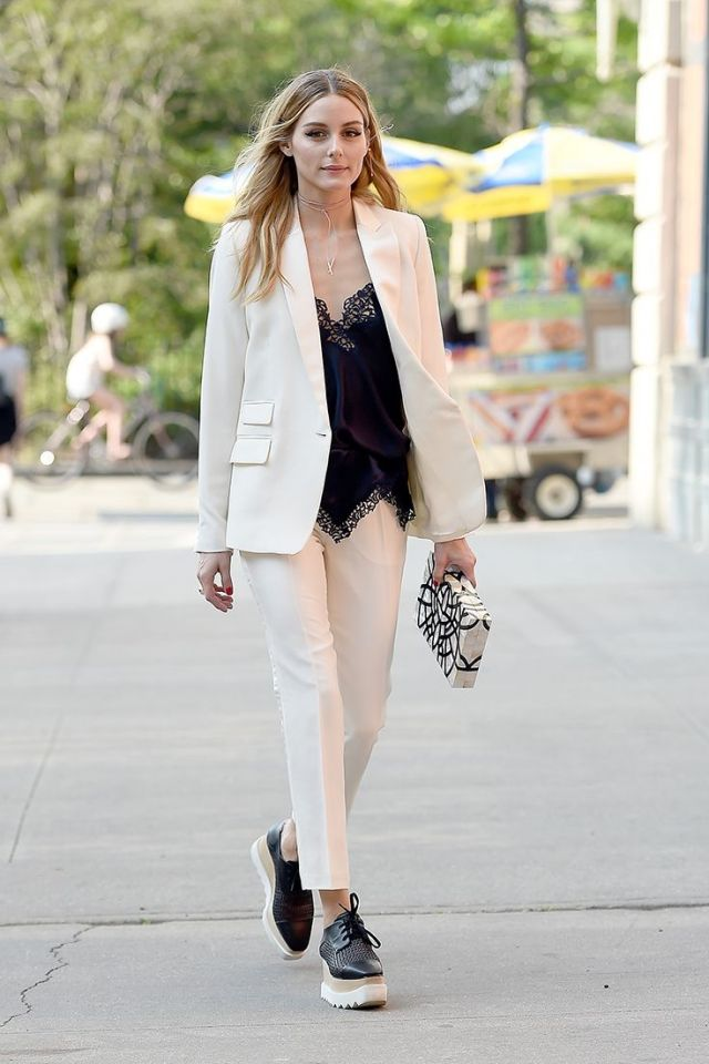 white suit with deep V-neckline